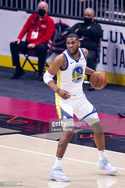 Kevon Looney of the Golden State Warriors looks across the court after gaining control of the ball during the first quarter against the Cleveland...