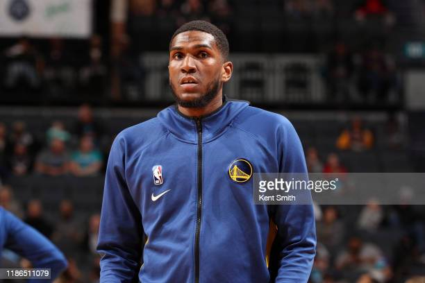 Kevon Looney of the Golden State Warriors looks on against the Charlotte Hornets on December 04 2019 at Spectrum Center in Charlotte North Carolina...