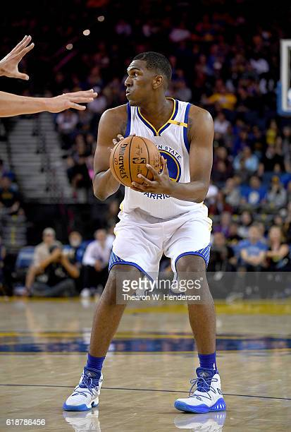 Kevon Looney of the Golden State Warriors looks to pass the ball against the Portland Trail Blazers during an NBA basketball game at ORACLE Arena on...