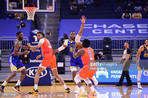 Kevon Looney of the Golden State Warriors plays defense against the Oklahoma City Thunder on April 8, 2021 at Chase Center in San Francisco,...