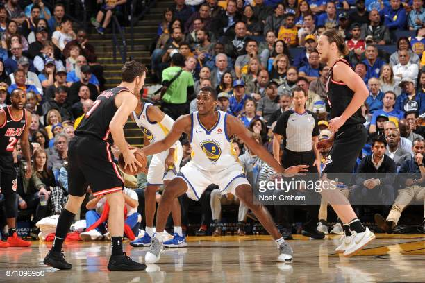 Kevon Looney of the Golden State Warriors plays defense against the Miami Heat on November 6 2017 at ORACLE Arena in Oakland California NOTE TO USER...