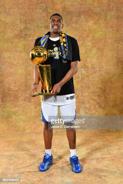 Kevon Looney of the Golden State Warriors poses for a portrait with the Larry O'Brien Trophy after defeating the Cleveland Cavaliers in Game Five of...