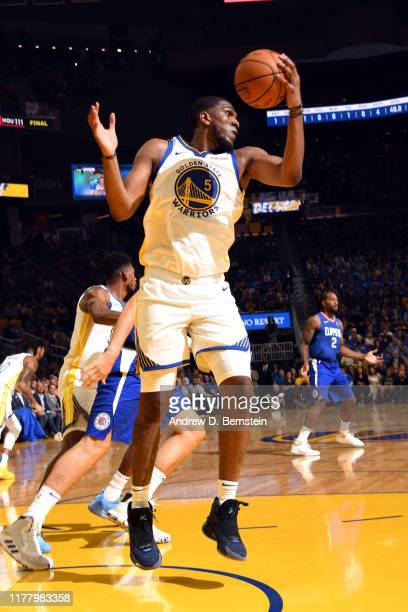 Kevon Looney of the Golden State Warriors rebounds the ball against the LA Clippers on October 24 2019 at Chase Center in San Francisco California...