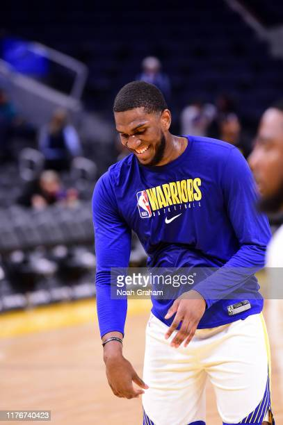 Kevon Looney of the Golden State Warriors smiles against the Los Angeles Lakers during a preseason game on October 18 2019 at Chase Center in San...