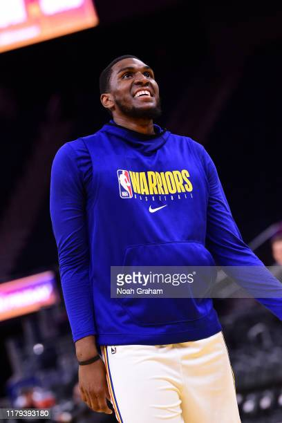 Kevon Looney of the Golden State Warriors smiles prior to a game against the San Antonio Spurs on November 1 2019 at Chase Center in San Francisco...