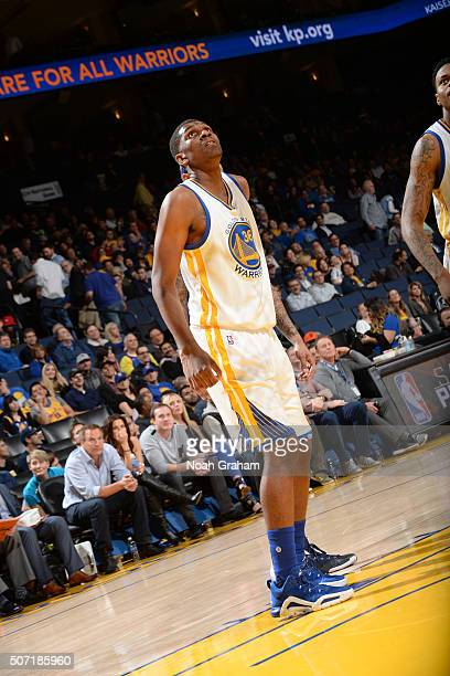Kevon Looney of the Golden State Warriors stands on the court during the game against the Dallas Mavericks on January 27 2016 at ORACLE Arena in...