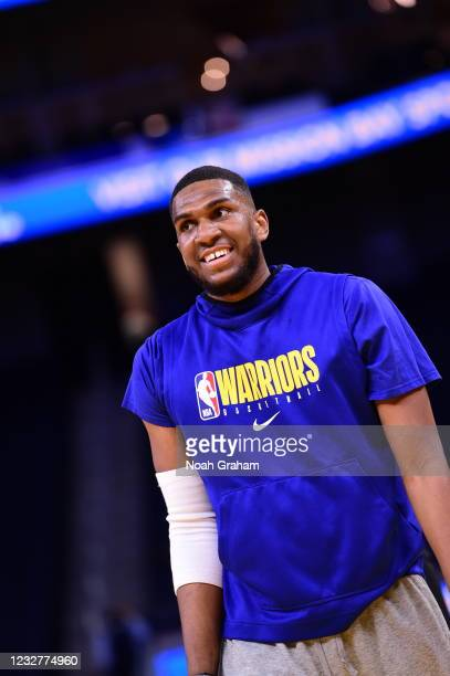 Kevon Looney of the Golden State Warriors warms up before the game against the Oklahoma City Thunder on April 8, 2021 at Chase Center in San...