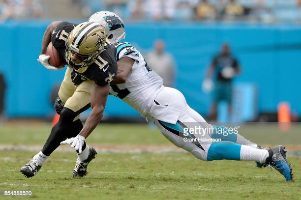 Kevon Seymour of the Carolina Panthers tackles Corey Fuller of the New Orleans Saints during their game at Bank of America Stadium on September 24...