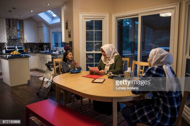 Kevser Ozer a mother of four who immigrated to the US from Turkey a year before 9/11 at home in Gaithersburg Maryland with her daughters...