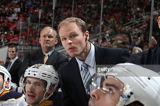 Kevyn Adams assistant coach of the Buffalo Sabres watches action on the ice during an NHL game against the Carolina Hurricanes on November 18 2011 at...