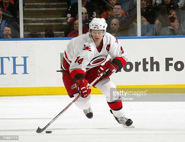Kevyn Adams of the Carolina Hurricanes skates with the puck during the game against the New York Islanders on November 22 2006 at the Nassau Coliseum...