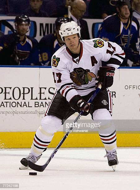 Kevyn Adams of the Chicago Blackhawks controls the puck near the blueline against the St Louis Blues during their preseason NHL game on September 29...