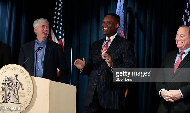 Kevyn Orr, emergency manager for Detroit, center, laughs during a news conference with Mike Duggan, mayor of Detroit, right, and Rick Snyder,...