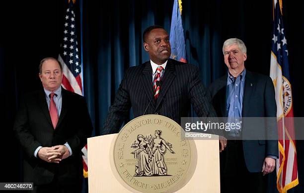 Kevyn Orr, emergency manager for Detroit, center, speaks at a news conference with Mike Duggan, mayor of Detroit, left, and Rick Snyder, governor of...