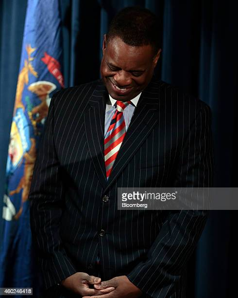Kevyn Orr, emergency manager for Detroit, smiles during a news conference at police headquarters in Detroit, Michigan, U.S., on Wednesday, Dec. 10,...
