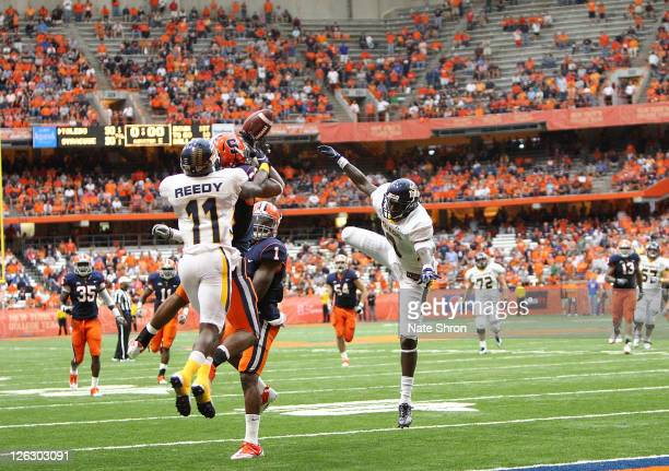 Kevyn Scott of the Syracuse Orange with an interception intended for Toledo Rockets' player Bernard Reedy in overtime during the game on September...