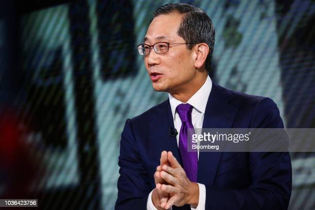 Kewsong Lee cochief executive officer of Carlyle Group LP speaks during a Bloomberg Television interview in New York US on Thursday Sept 20 2018 Lee...