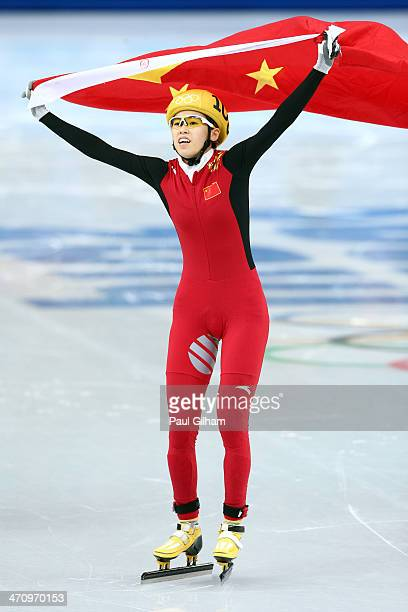 Kexin Fan of China celebrates winning the silver medal in the Short Track Women's 1000m Final A on day fourteen of the 2014 Sochi Winter Olympics at...