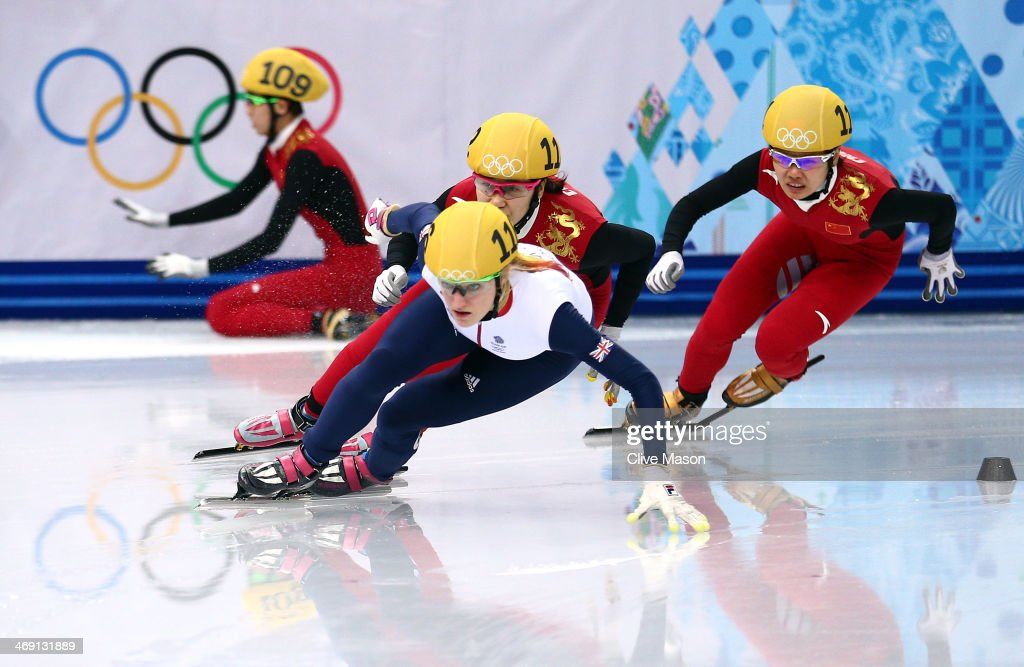 Kexin Fan of China (L) falls as Elise Christie of Great Britain, Qiuhong Liu of China and Jianrou Li of China race on in the Short Track Speed Skating Ladies' 500m Semifinal on day 6 of the Sochi 2014 Winter Olympics at at Iceberg Skating Palace on February 13, 2014 in Sochi, Russia.