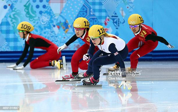 Kexin Fan of China falls as Elise Christie of Great Britain Qiuhong Liu of China and Jianrou Li of China race on in the Short Track Speed Skating...