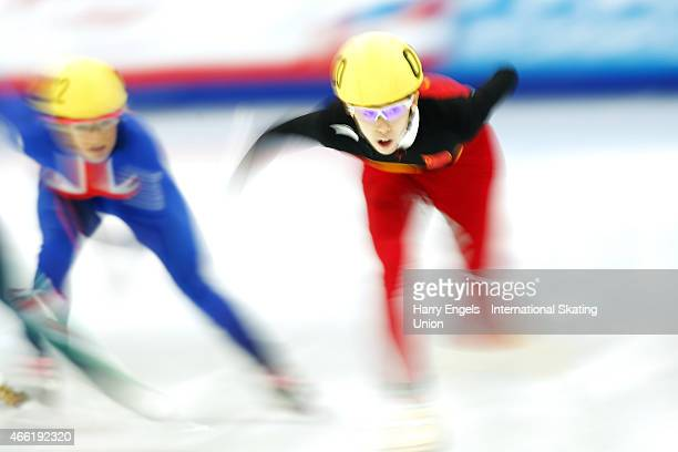 Kexin Fan of China leads Elise Christie of Great Britain during the Ladies 500m Final on day two of the ISU World Short Track Speed Skating...