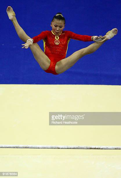 Kexin He of China competes in the uneven bars during the second day of the Artistic Gymnastics World Championships 2009 at O2 Arena on October 14...