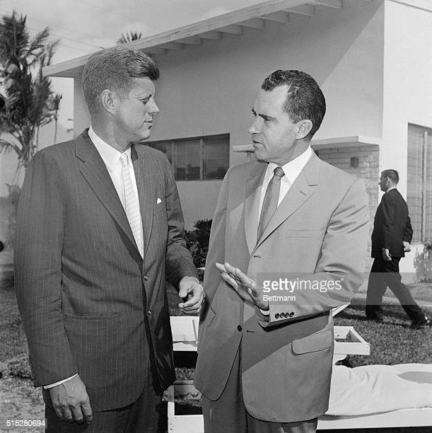 Key Biscayne, Florida -- President-elect John Kennedy, and Vice President Richard Nixon exchange a few last words before Kennedy returned to his...