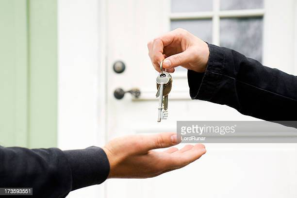 key exchange - house key stock photos and pictures