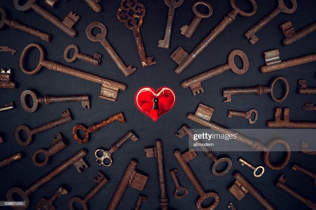 key for heart on blackboard : Stock Photo