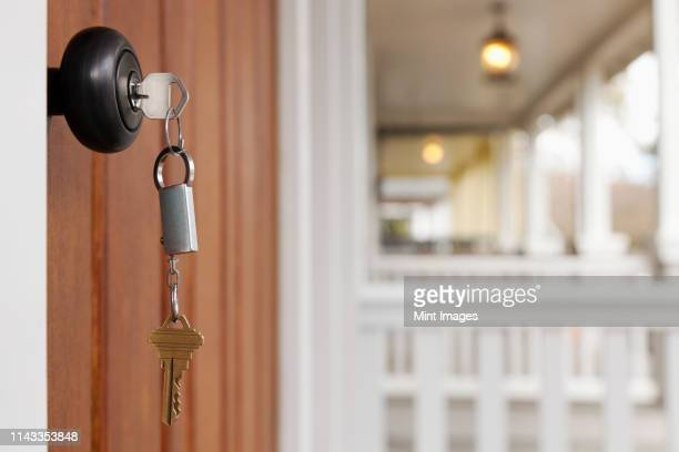 key in front door - real estate stock pictures, royalty-free photos & images