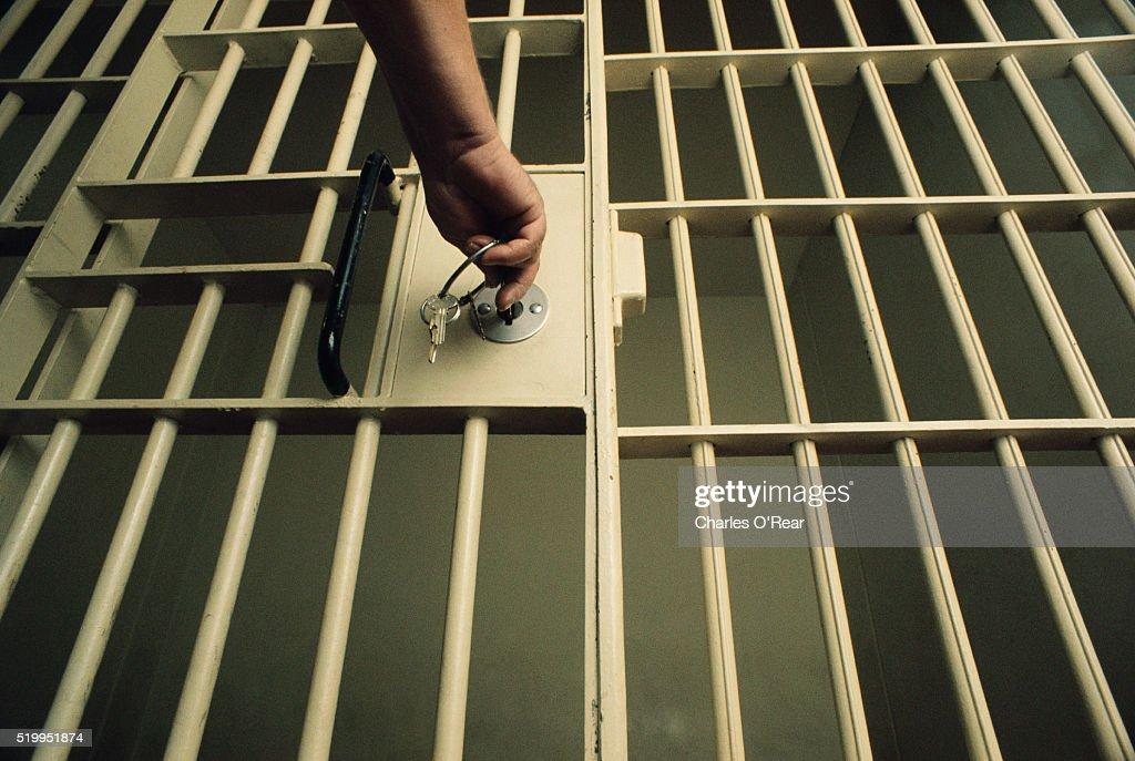 Key in Jail Cell Door : Stock Photo