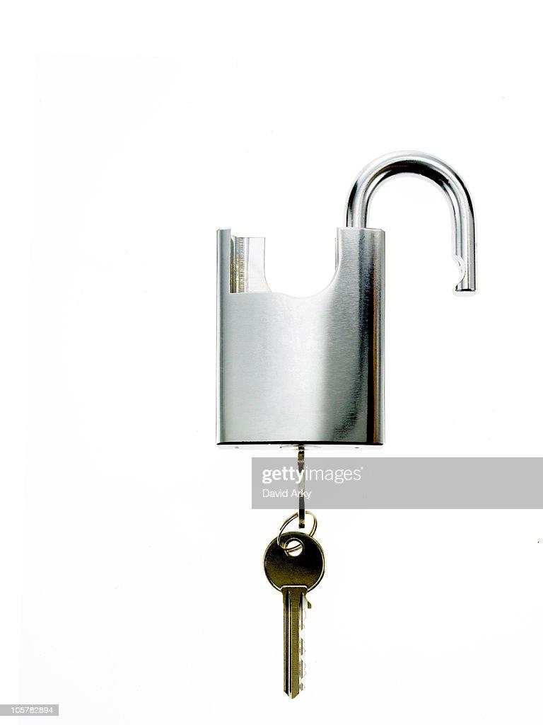 Key in padlock : Stock Photo
