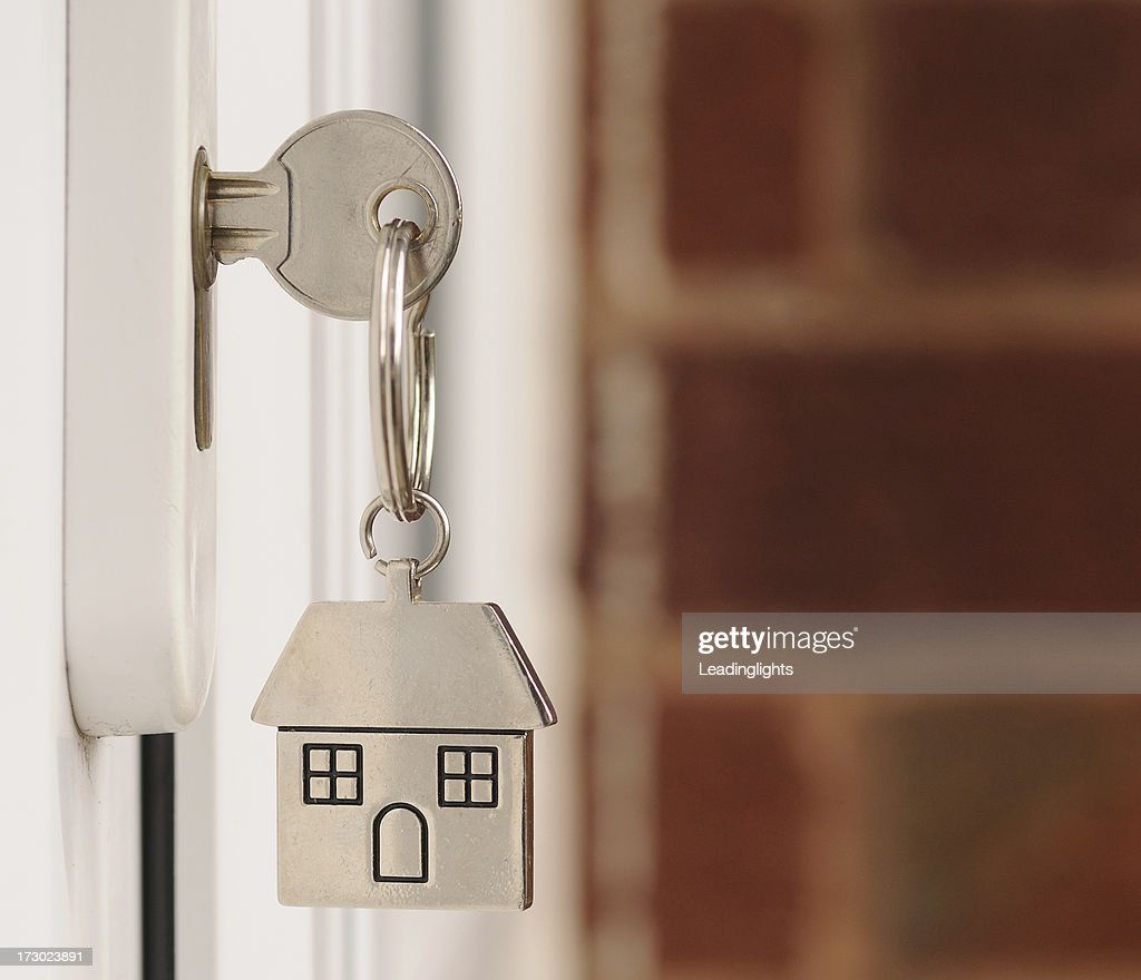 Key in the Door with copyspace : Stock Photo