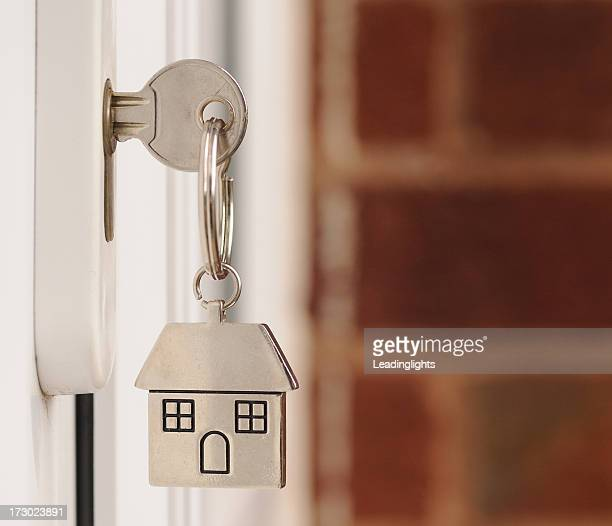 key in the door with copyspace - house key stock photos and pictures