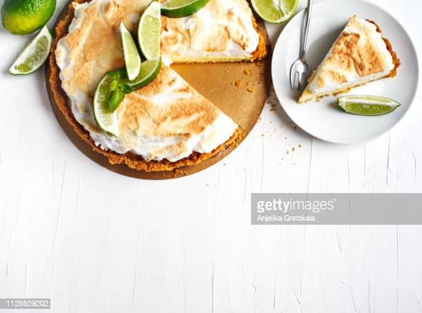key lime pie. citrus pie with meringue - dessert stock pictures, royalty-free photos & images