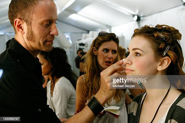 Key makeup artist Gregory Arlt and model Sophie Simmons backstage at the Kelly Nishimoto Debuts Imasu Collection Fall 2008 on March 9 2008 at...