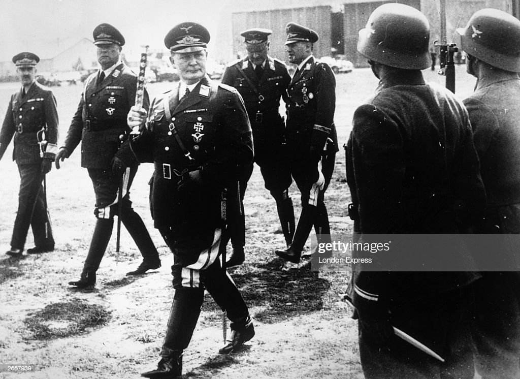 Key Nazi German military and political leader, Hermann Goering (1893 - 1946), inspects German troops in Vienna, following the 'Anschluss' and the German occupation of Austria.