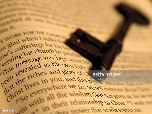 key on a bible - gospel stock photos and pictures