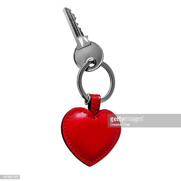 key on a leather heart shaped keyring - house key stock photos and pictures