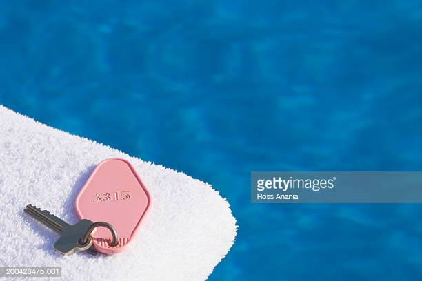 key on towel over water, elevated view - hotel key stock photos and pictures