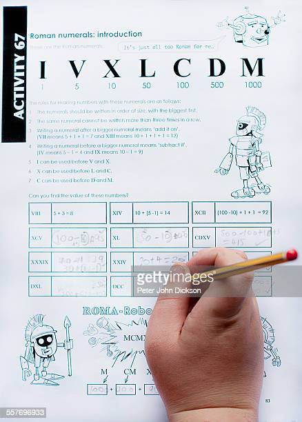Key stage 2 British primary school homework consisting of Roman numerals of maths equations