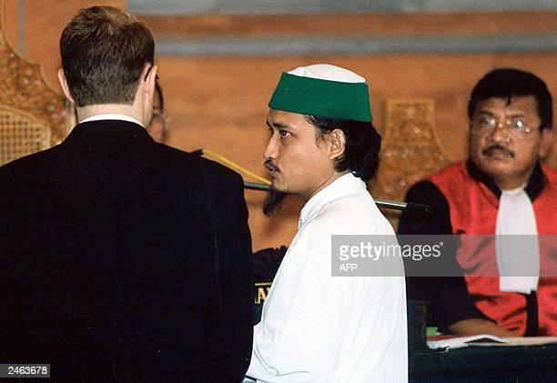 Key suspect in the 2002 Bali bombing Abdul Aziz alias Imam Samudra gives a sharp glance at Australian federal police expert Nicholas Klein when asked...