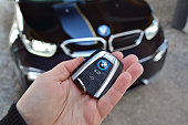 Key to the electric BMW in a hand