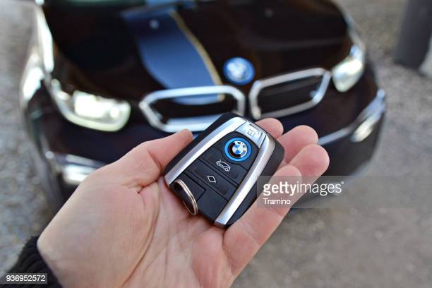 key to the electric bmw in a hand - bmw stock pictures, royalty-free photos & images