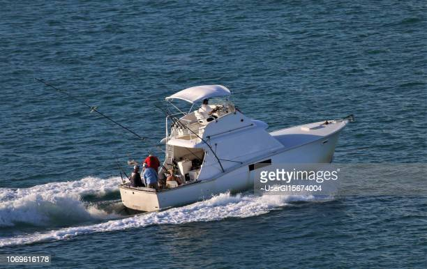 Key West, Florida – November 5, 2018: Fishermen returning from a day of deep-sea fishing.