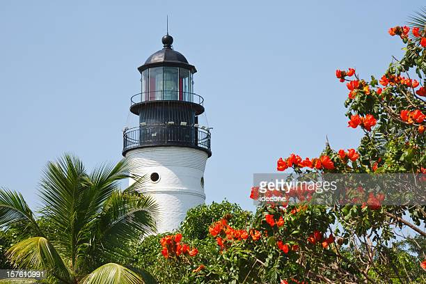 key west lighthouse on a clear day - key west stock photos and pictures