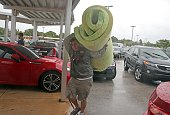 key west resident carries bedding into
