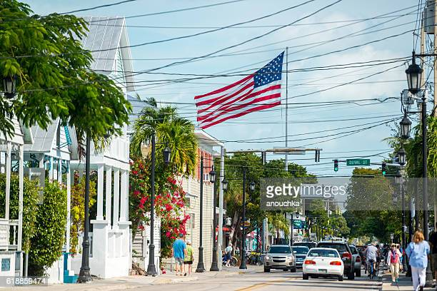Key West street with giant American Flag, Florida, USA
