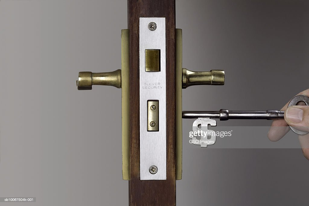 Key with dollar sign unlocking door  Stock Photo & Key With Dollar Sign Unlocking Door Stock Photo | Getty Images