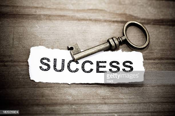 Key with success written on paper